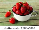 Strawberries In Cup On Green...