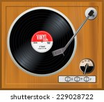 old wooden turntable. vintage... | Shutterstock .eps vector #229028722