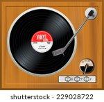 old wooden turntable. vintage... | Shutterstock .eps vector #229028722