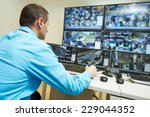 security guard watching video... | Shutterstock . vector #229044352