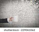 close up of hand holding a... | Shutterstock . vector #229061062