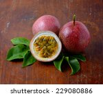 passion fruits on wooden... | Shutterstock . vector #229080886
