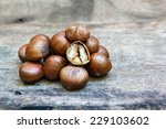 sweet chestnut on wood... | Shutterstock . vector #229103602