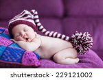 cute sleeping baby with hat | Shutterstock . vector #229121002