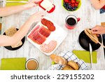 a family having breakfast at... | Shutterstock . vector #229155202