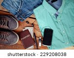 man is accessories on a wooden... | Shutterstock . vector #229208038