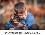 Stock photo boy with german shepherd dog puppy 229231762