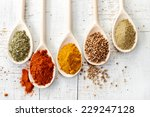 Various Spices In Wooden Spoon...