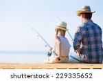 father and daughter fishing on... | Shutterstock . vector #229335652