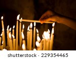 Woman Hand Lighting Candles  I...
