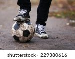 soccer ball on ground in rainy... | Shutterstock . vector #229380616