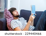 caucasian student man reading a ... | Shutterstock . vector #229440466