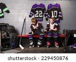 two boys get dressed in hockey... | Shutterstock . vector #229450876