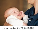 sweet baby boy on father's... | Shutterstock . vector #229453402