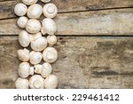 Mushrooms On Wooden Background...