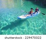 Kayaking. Young Happy Couple...