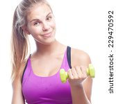 young cool woman with a dumbbell | Shutterstock . vector #229470592