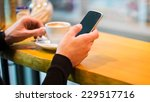 man using a cell phone on cafe... | Shutterstock . vector #229517716
