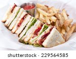 clubhouse sandwich with fries | Shutterstock . vector #229564585