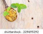 fish oil capsules in a spoon. | Shutterstock . vector #229695292