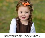 Lovely Toddler Girl With Happy...