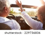 mature couple driving along... | Shutterstock . vector #229736836