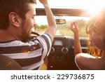 young couple driving along... | Shutterstock . vector #229736875