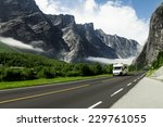 camping holidays car on the mountain road, norway - stock photo