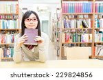 Asian Student Studying In The...