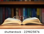 Glasses And Book On Background...