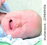 tearful baby | Shutterstock . vector #229849456