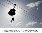silhouette of a cabin ski lift... | Shutterstock . vector #229909405