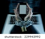 Hands of caucasian businessman addicted to mobile phone bond and locked with iron chain wrists in smartphone internet addiction and slave to online network addict concept - stock photo