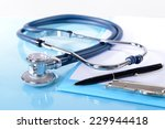 stethoscope on light blue... | Shutterstock . vector #229944418