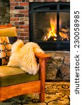 Chair By A Cozy Fireplace With...