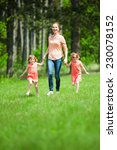 mother with twin girls walking... | Shutterstock . vector #230078152