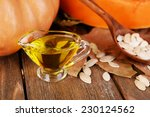 pumpkin seed oil in glass sauce ... | Shutterstock . vector #230124562