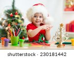 Child Girl In Santa Hat Making...