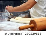 baker poured flour on the table ... | Shutterstock . vector #230229898