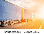 semitruck driving to sunset | Shutterstock . vector #230252812