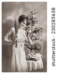 Young Woman With Christmas Tree ...
