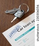 Small photo of Approved car loan application with car keys