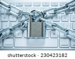 Close Up Of Laptop With Chains...