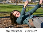 Young woman on the swings - stock photo