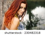 red haired girl smiling on the... | Shutterstock . vector #230482318