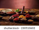 hot spices in wooden bowls | Shutterstock . vector #230510602