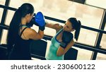 Постер, плакат: Two Female Boxers At