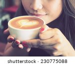 beautiful girl drinking tea or... | Shutterstock . vector #230775088