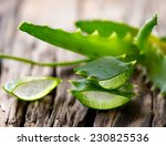 Aloe Vera Leaves On Wooden...