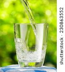 glass of water on nature... | Shutterstock . vector #230863552